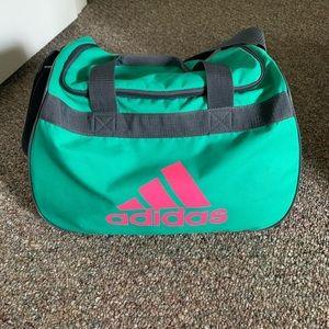 Green and pink adidas bag